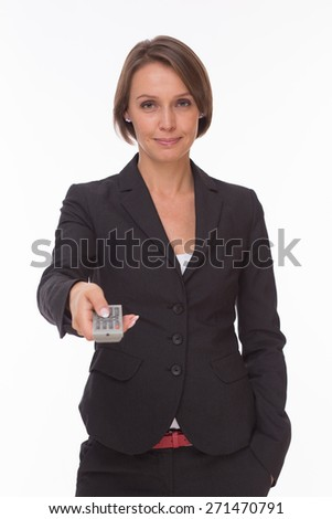 Businesswoman stay with remote control isolated on white - stock photo