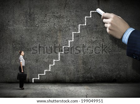 Businesswoman stepping ladder drawn by hand with chalk - stock photo
