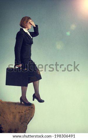 businesswoman stepping off a cliff or precipice without looking - stock photo