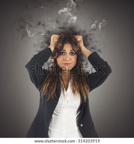 Businesswoman stressed with her head in smoke - stock photo