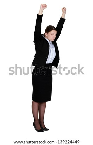 Businesswoman stretching at work - stock photo