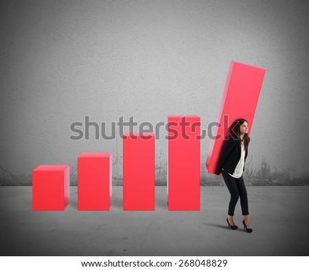 Businesswoman struggling attempts to raise the profit - stock photo