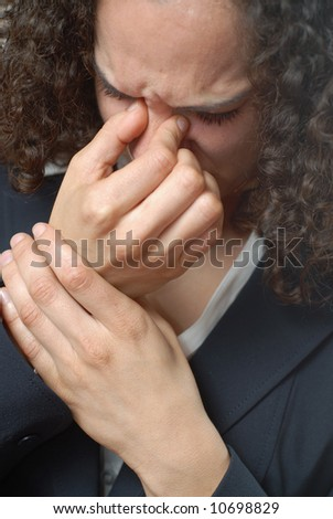 Businesswoman suffering at work from the flu or sinus headache - stock photo