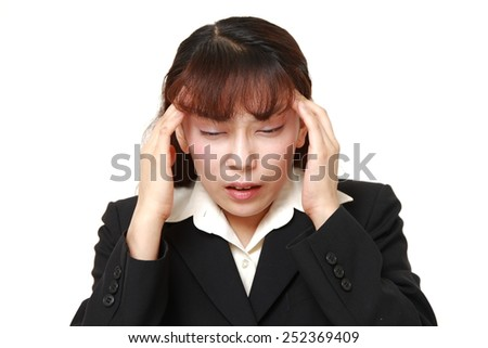 businesswoman suffers from headache  - stock photo