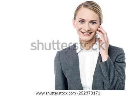 Businesswoman talking on cell phone over white - stock photo