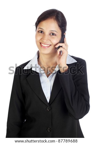 Businesswoman talking on cellphone - stock photo