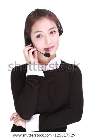 Businesswoman talking on headset - stock photo
