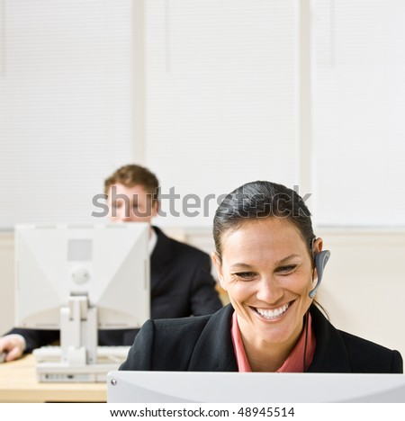 Businesswoman talking on headset - stock photo