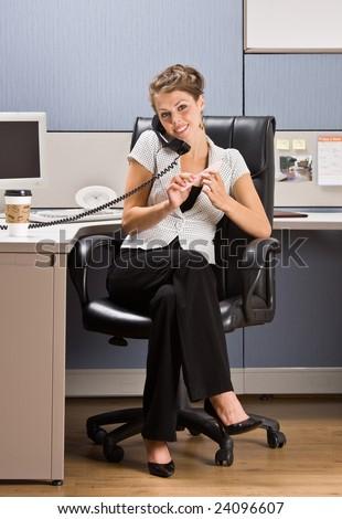 Businesswoman talking on telephone - stock photo
