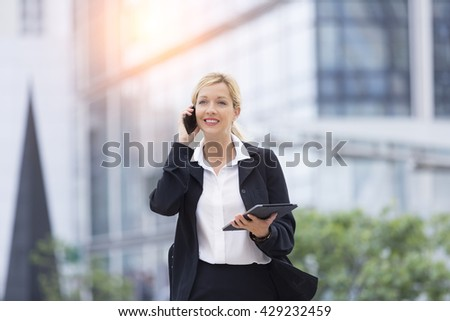 Businesswoman talking on the phone - stock photo