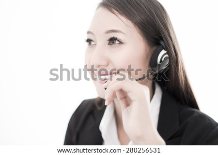 businesswoman talking on the phone while working on her computer - stock photo