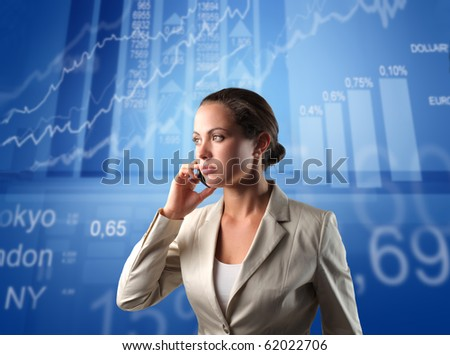 Businesswoman talking to telephone with exchange graphics on the background
