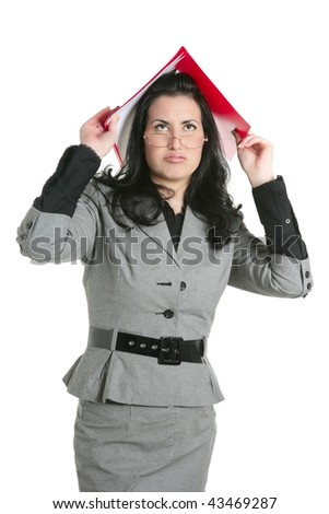 Businesswoman teacher woman busy upset folders in head - stock photo