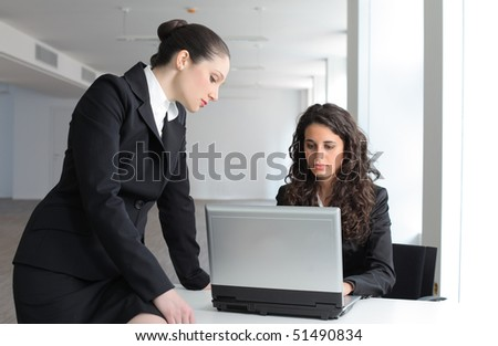 Businesswoman teaching employee - stock photo