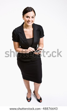 Businesswoman text messaging on cell phone - stock photo