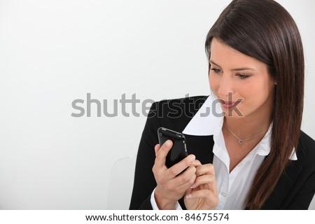 Businesswoman texting - stock photo