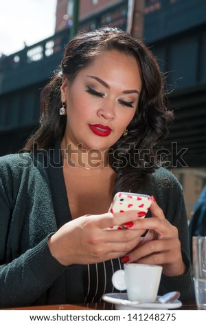 Businesswoman texting on coffee break in NYC - stock photo