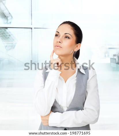 Businesswoman think looking up to empty copy space, young attractive business woman think, idea, hold hand finger on chin. concept pondering in modern office - stock photo