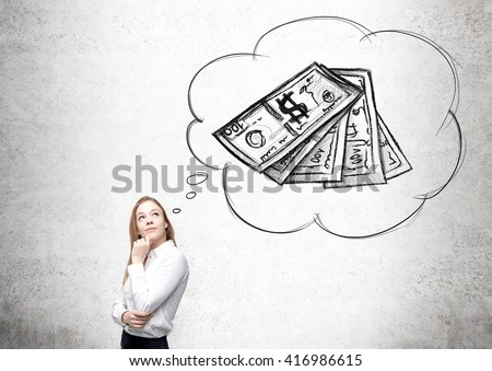 Businesswoman thinking about money on concrete wall background - stock photo