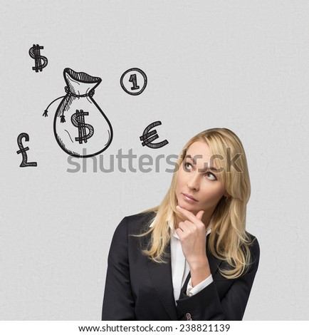 businesswoman thinking and drawing money bag on wall - stock photo