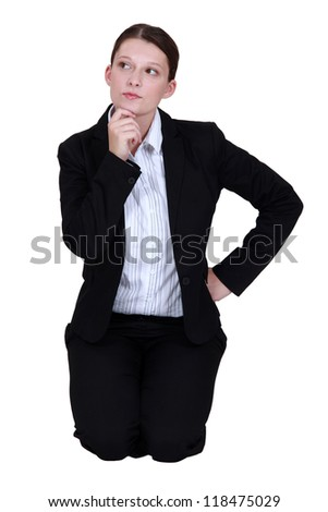 businesswoman thinking and holding her chin - stock photo