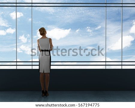 businesswoman thinking in office and looking to window - stock photo