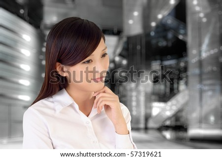 Businesswoman thinking inside of modern architecture, closeup portrait of oriental office lady. - stock photo