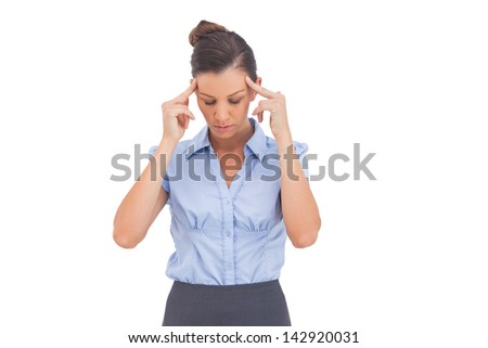 Businesswoman thinking with fingers on her temples and closed eyes