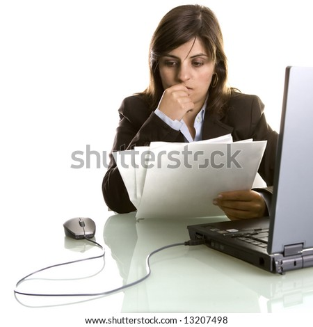 businesswoman thinking with reports in the hand - stock photo