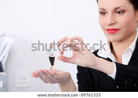 Businesswoman throwing a subordinate out of work. - stock photo