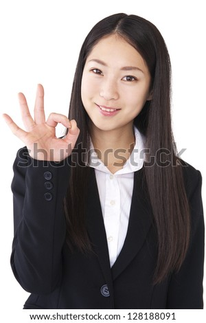 Businesswoman to the OK sign