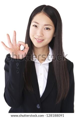 Businesswoman to the OK sign - stock photo