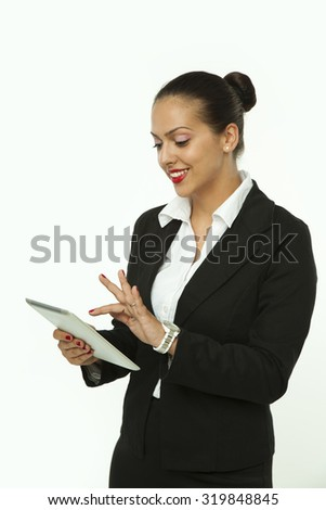 Businesswoman touch the Digital Tablet in the Office