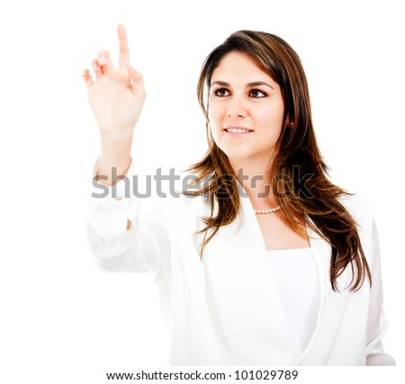Businesswoman touching and imaginary screen with her finger - isolated - stock photo