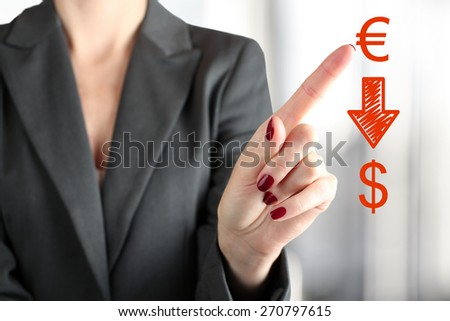 Businesswoman Touching   dropping  euro    to dollar fby finger