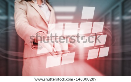 Businesswoman touching futuristic bar chart in data center - stock photo