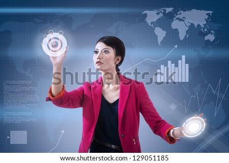 Businesswoman touching futuristic touchscreen on blue world map background - stock photo