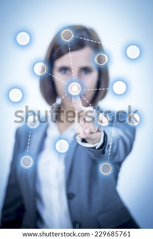 Businesswoman touching Screen Concept Networks - stock photo