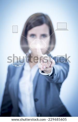 Businesswoman touching visual screen - stock photo