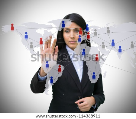 Businesswoman touching world map interface with figures - stock photo