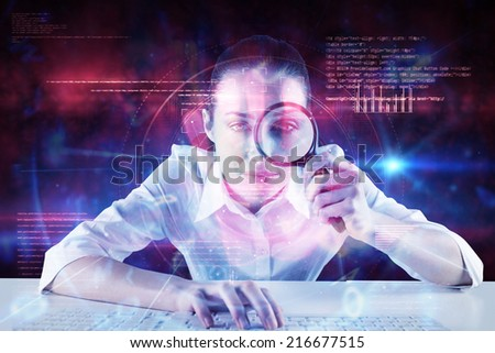 Businesswoman typing and looking through magnifying glass against pink technology hand print interface design - stock photo