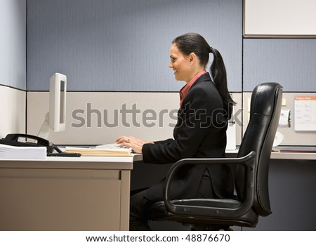 Businesswoman typing on computer - stock photo