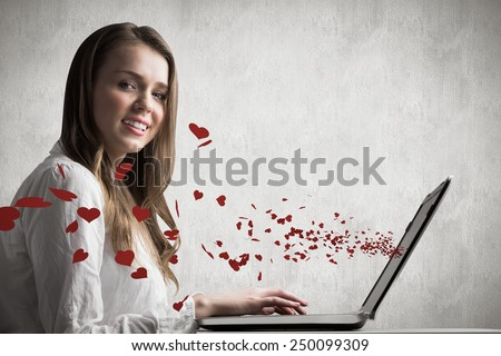 Businesswoman typing on her laptop against white and grey background - stock photo