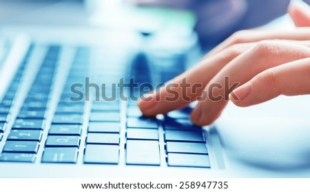businesswoman typing on laptop computer - stock photo