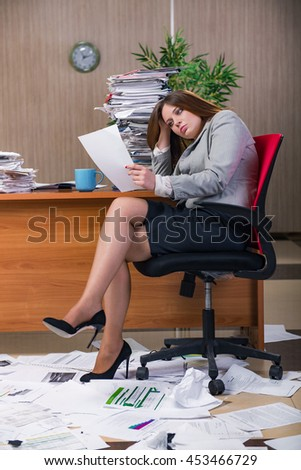 Businesswoman under stress working in the office - stock photo