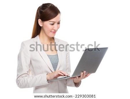 Businesswoman use of laptop - stock photo