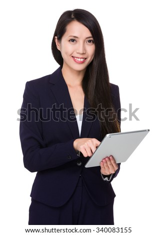 Businesswoman use of the tablet computer