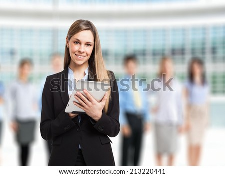 Businesswoman using a digital tablet in front of a group of people - stock photo