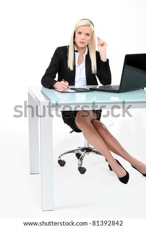 Businesswoman using a telephone headset - stock photo