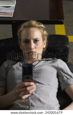 Businesswoman Using Cell Phone - stock photo